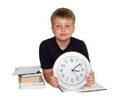 Boy looking at a clock
